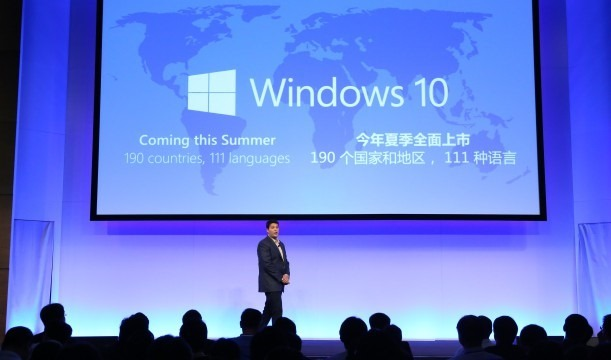 Terry-on-stage-in-front-of-Win10-LOGO-1-611x360